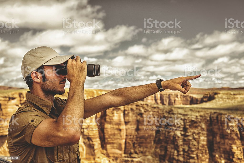 park ranger looking forward on the grand canyon stock photo
