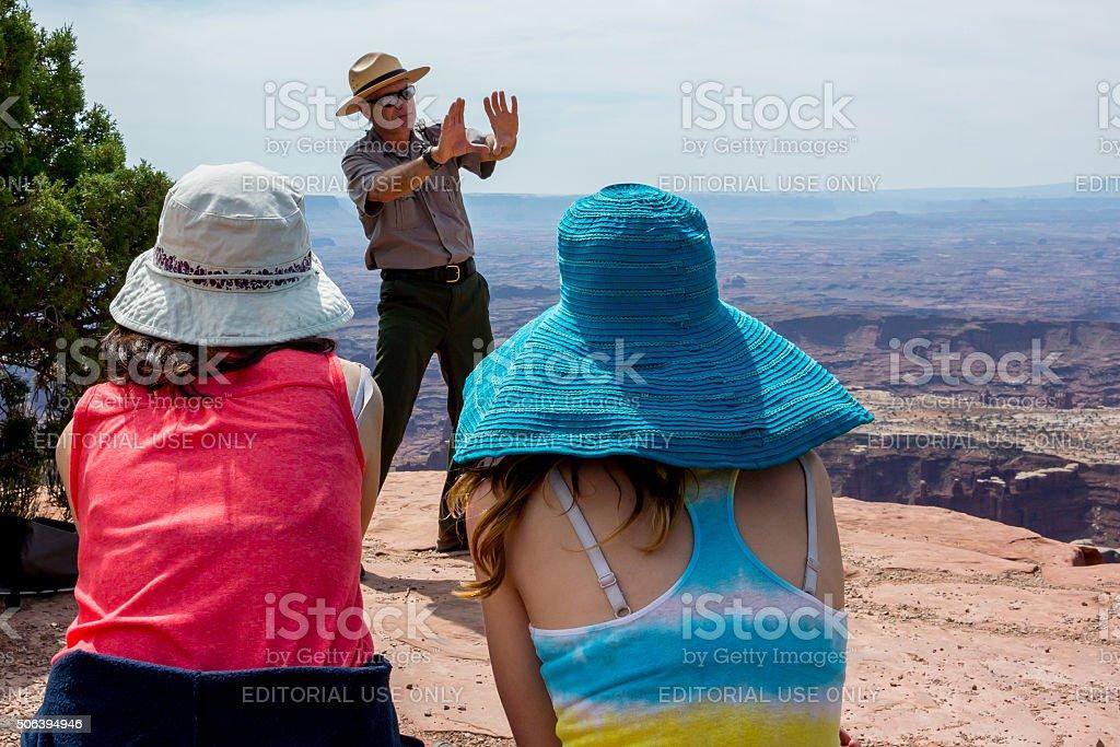 NPS Park Ranger Talking at Island in the Sky stock photo