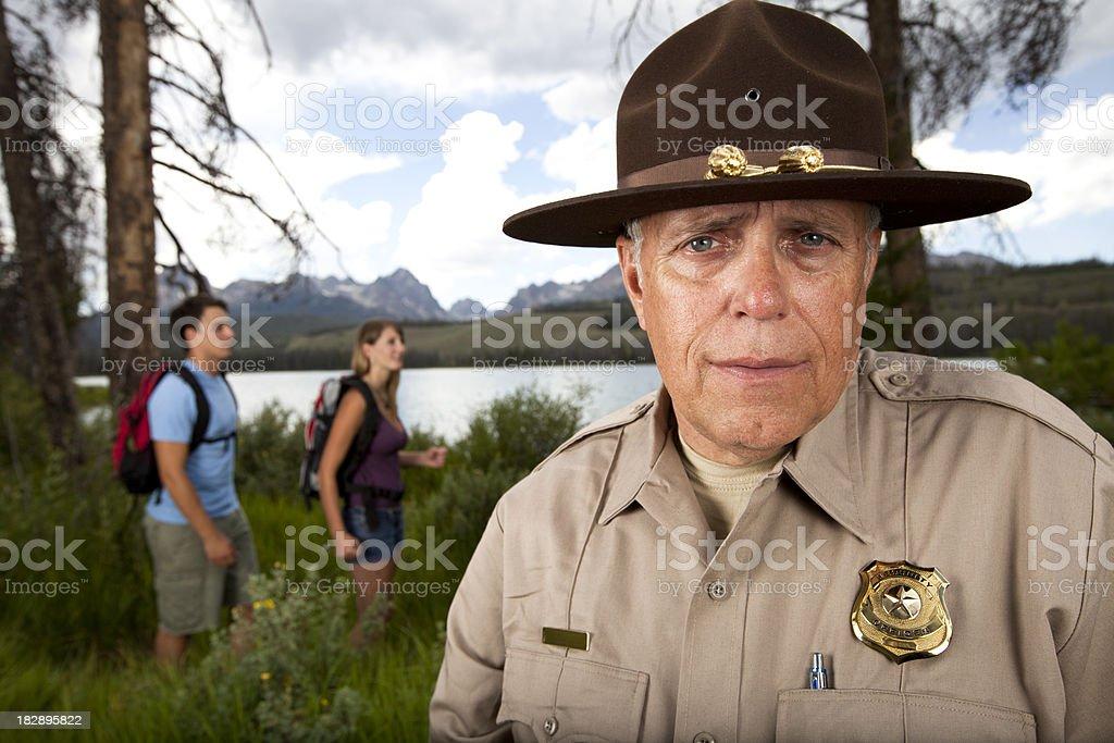 Park Ranger watching hikers stock photo