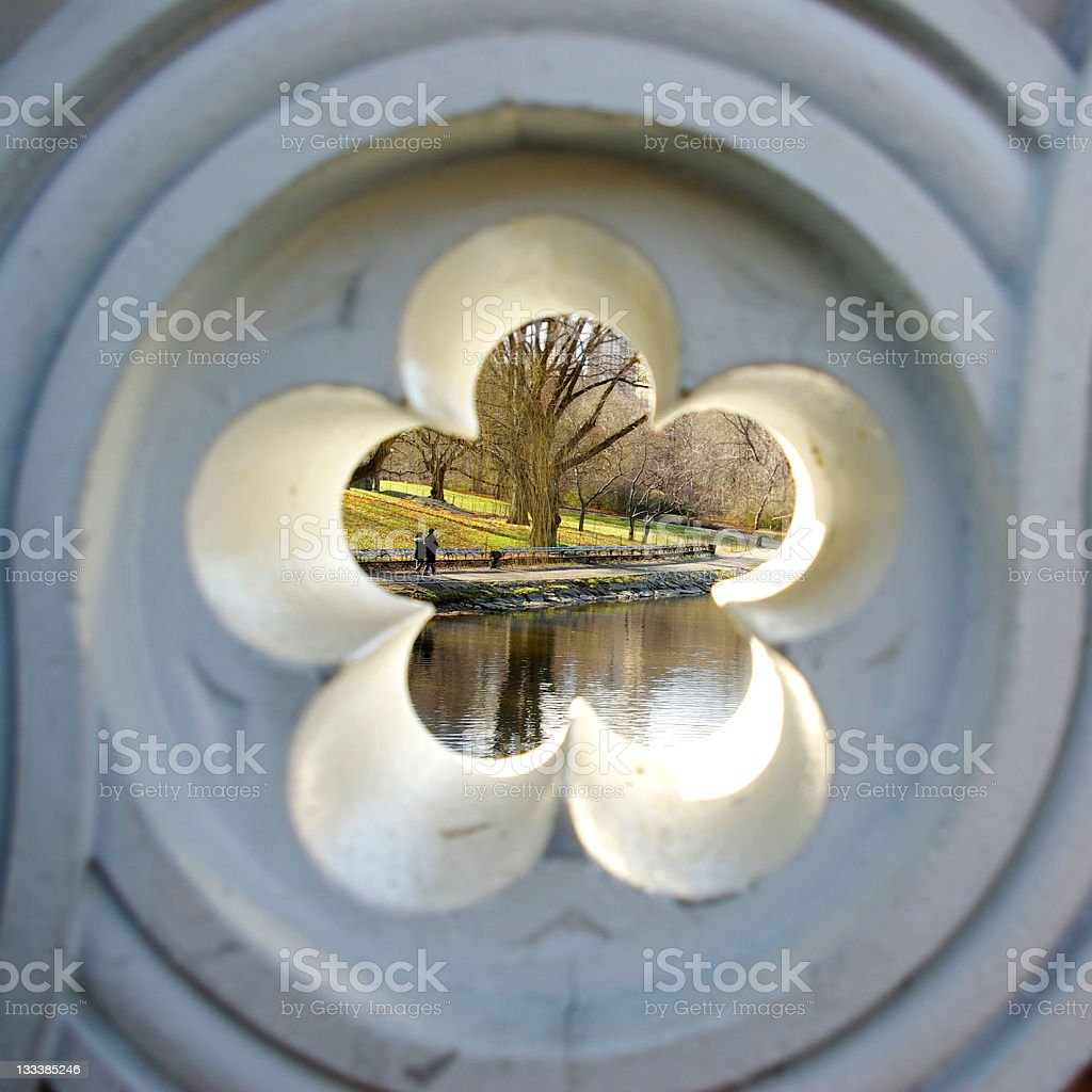 park scene with lake seen through floral designed hole royalty-free stock photo