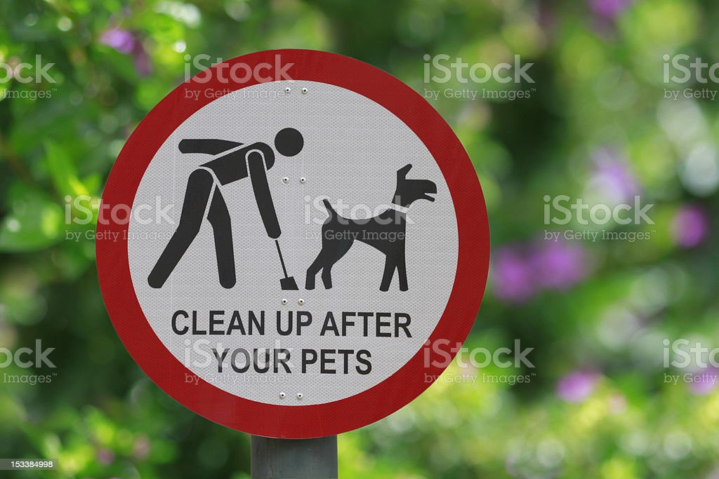 Park sign in red and white with plants stock photo