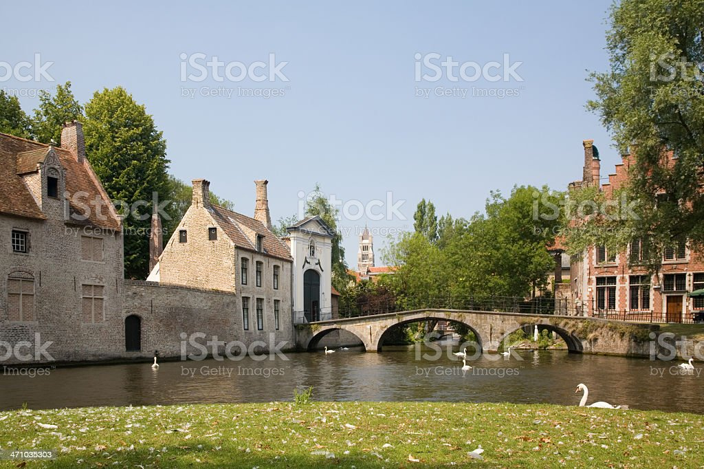 Park with Beguinage bridge in Bruges royalty-free stock photo