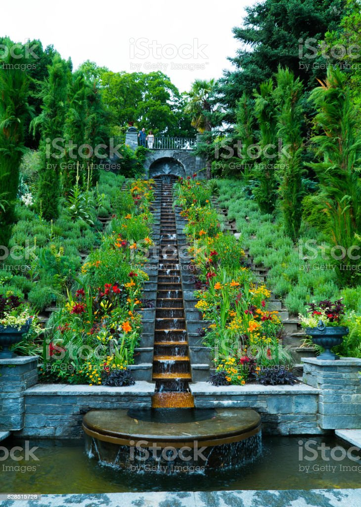 Park with flowers and artificial waterfall in Italian style on the island of Mainau in Germany stock photo