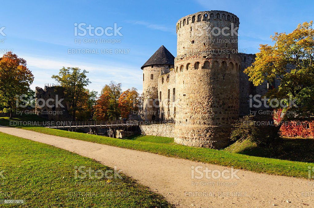 Park with old castle ruins in Cesis town, Latvia stock photo