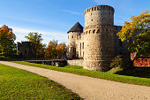 Park with old castle ruins in Cesis town, Latvia