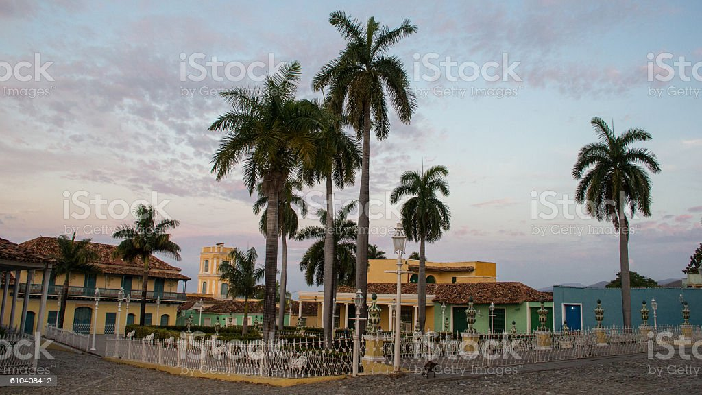 Park with palmtrees and colorful buildings in Sancti Spiritus stock photo