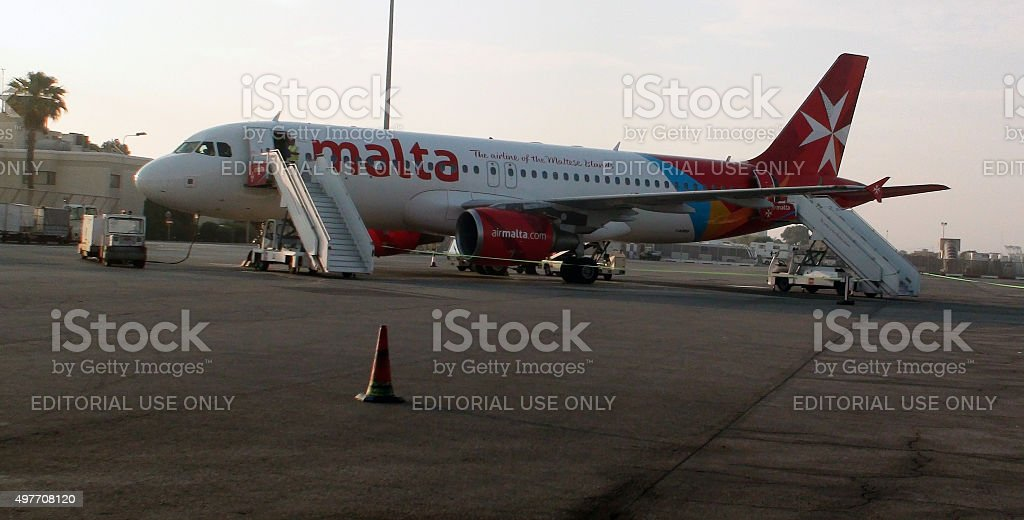Parked Air Malta Passenger Airplane At Airport Loading Gate.Malta,Europe stock photo