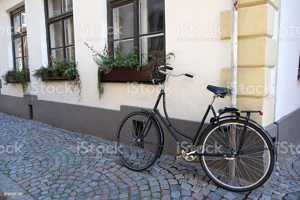 Parked bicycle in narrow street. stock photo