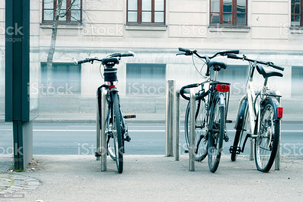 Parked bicycles in a city stock photo
