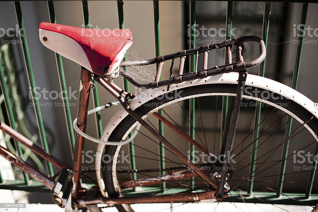Parked Bike, Green Fence. stock photo