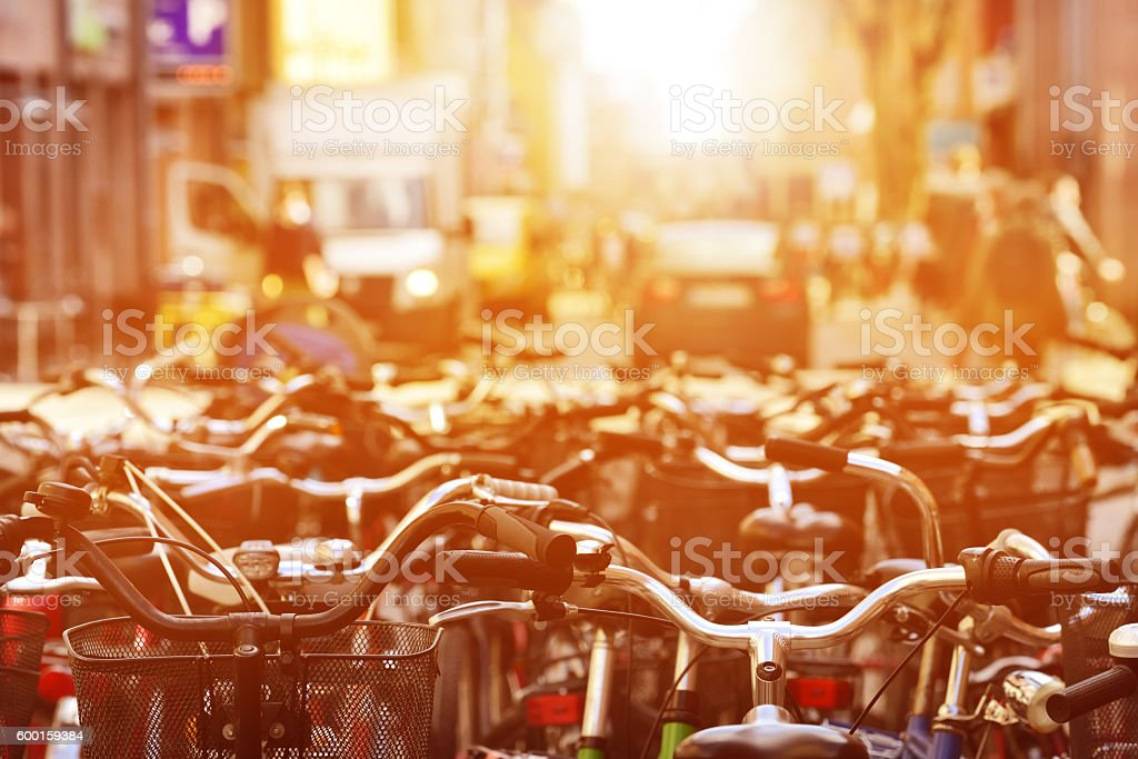 Parked bikes in sunset stock photo