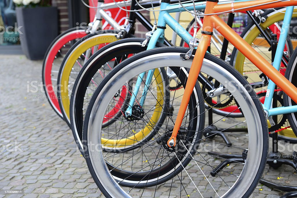 Parked bikes on sidewalk in the city royalty-free stock photo