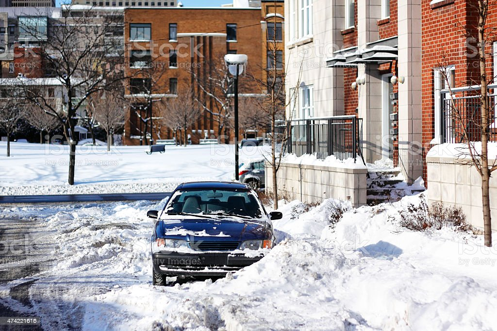 Parked car covered with snow in Montreal stock photo