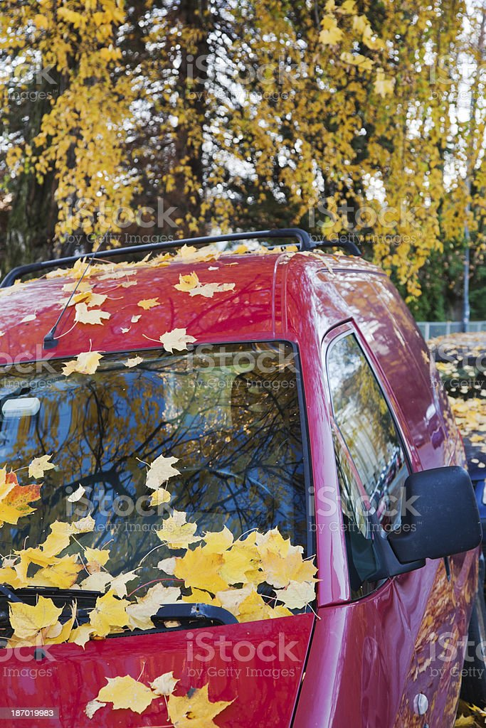 Parked car in fall. royalty-free stock photo