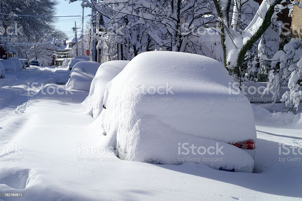 Parked Cars Covered with Snow in Blizzard on City Street stock photo