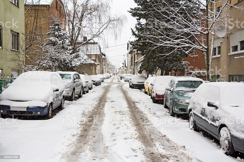 Parked Cars covered with snow stock photo