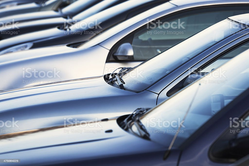 parked cars in a row stock photo