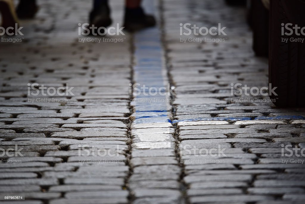 Parked cars on street, blurred pedestrians in background stock photo