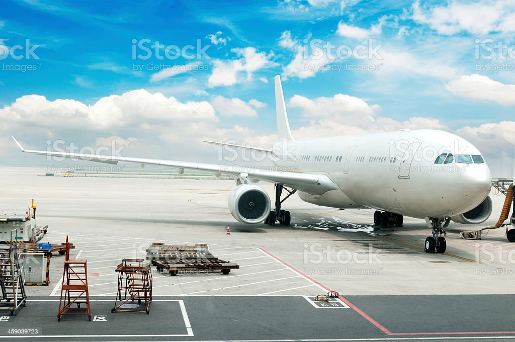 Parked plane at airport loading stock photo
