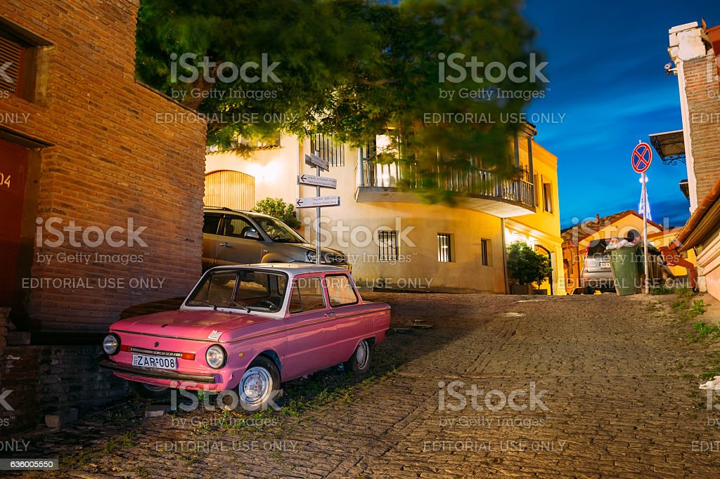 Parked Rarity Tuning Pink Minicar Zaporozhets On Paved Street In stock photo