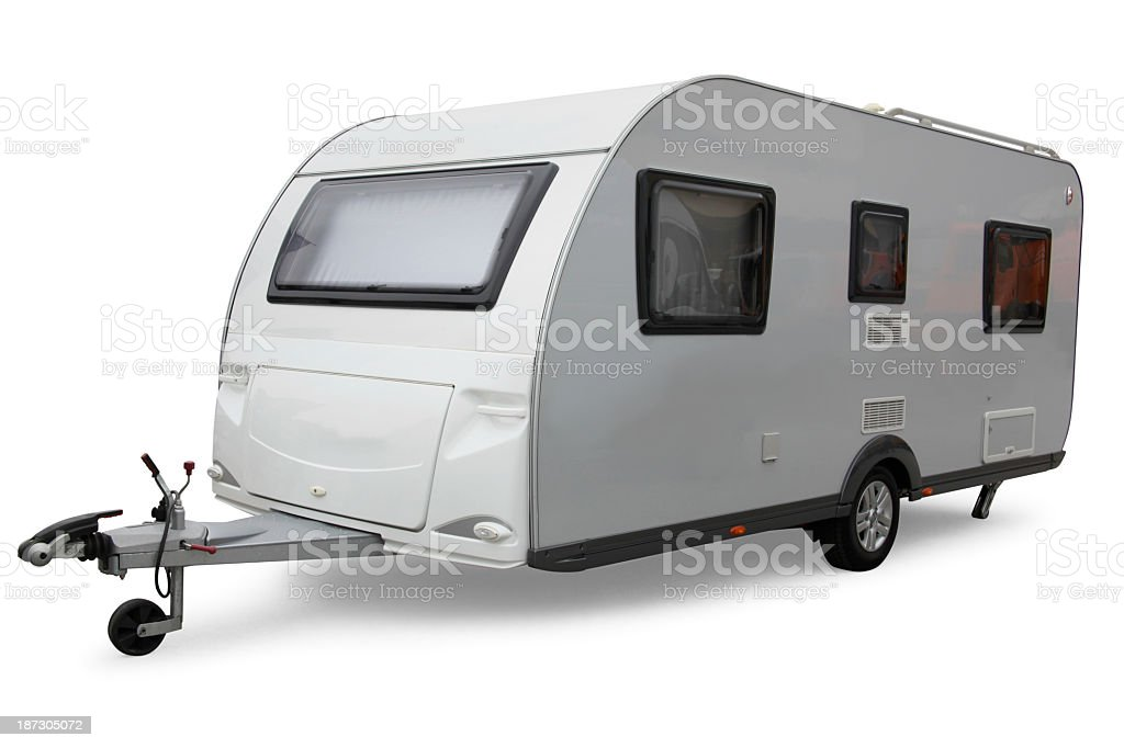 Parked white caravan isolated on white background stock photo