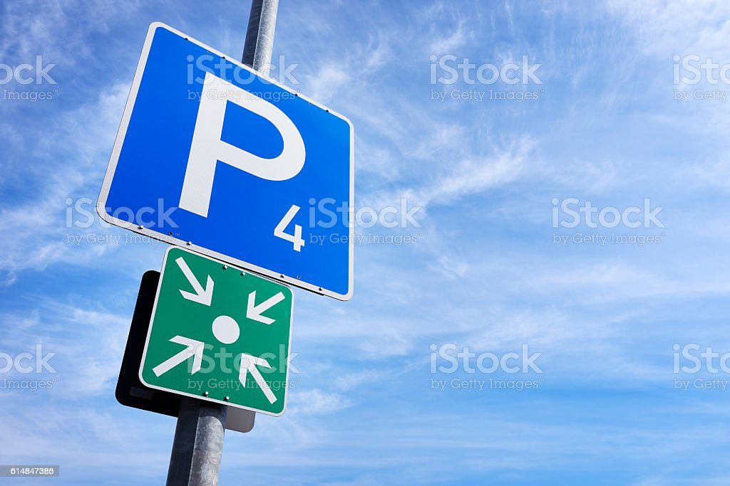Parking and meeting point sign and fluffy clouds stock photo