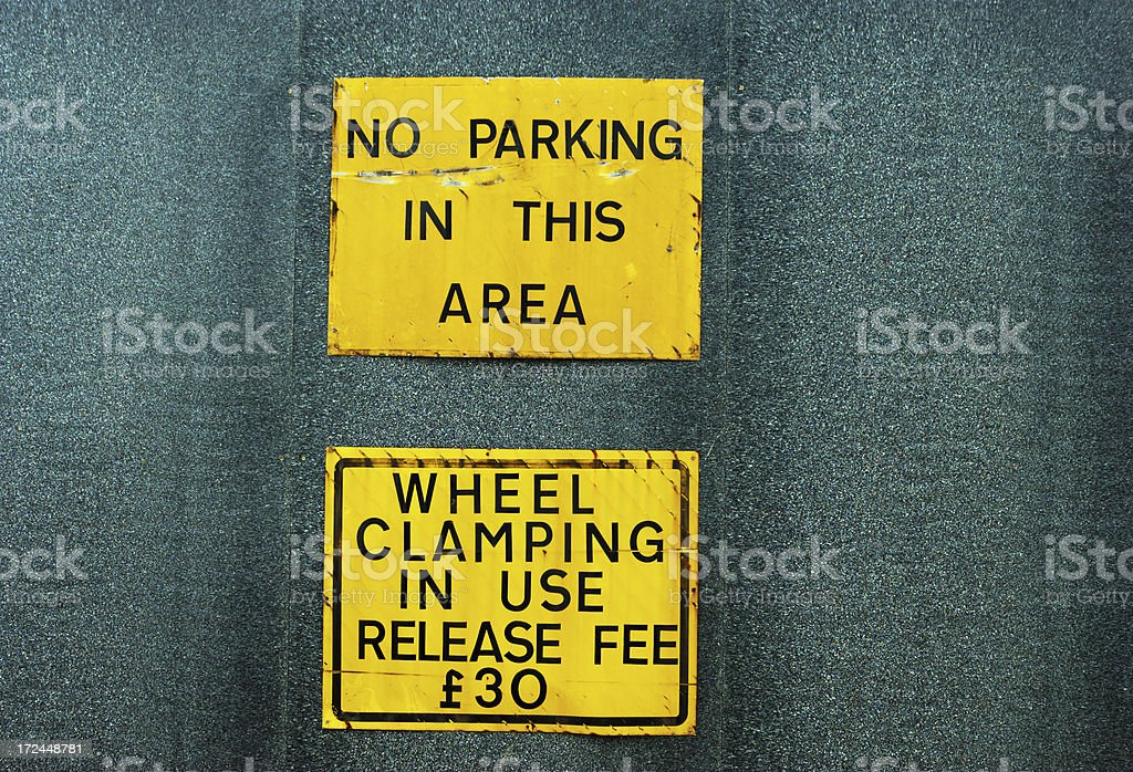 Parking and wheel clamping signs stock photo