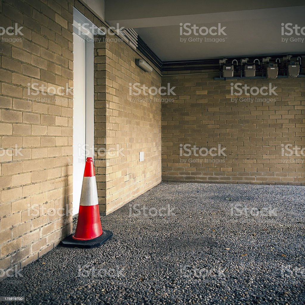 Parking Bay with Door and Traffic Cone royalty-free stock photo
