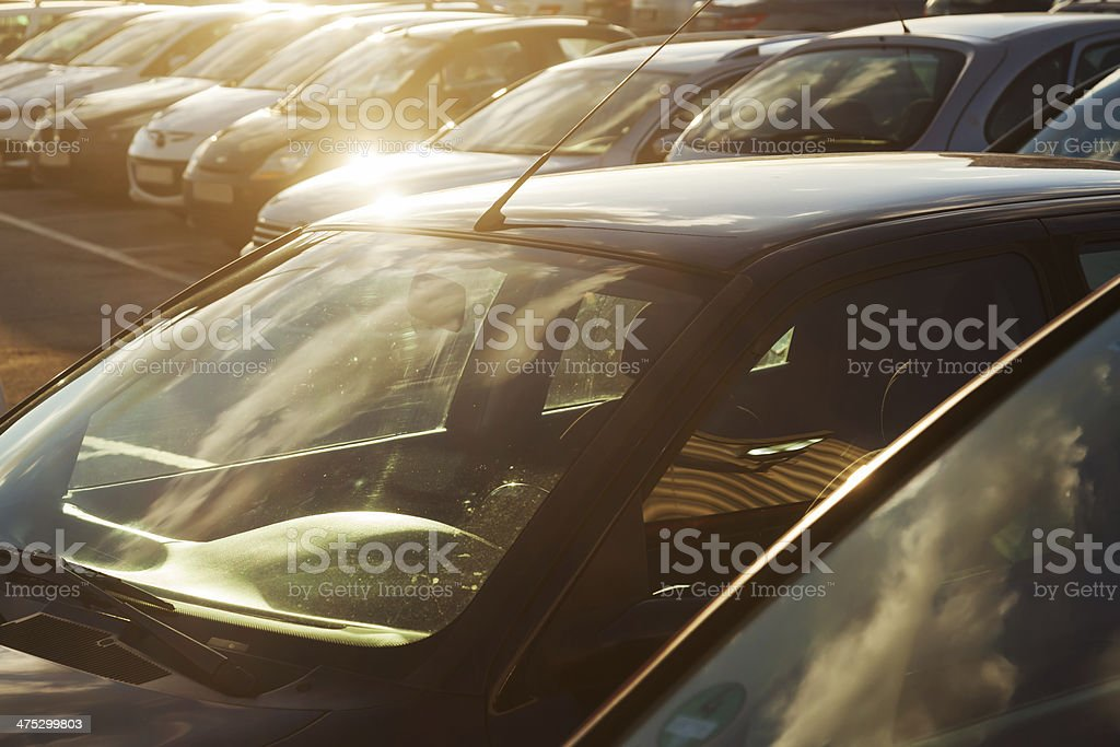 parking cars in backlit stock photo