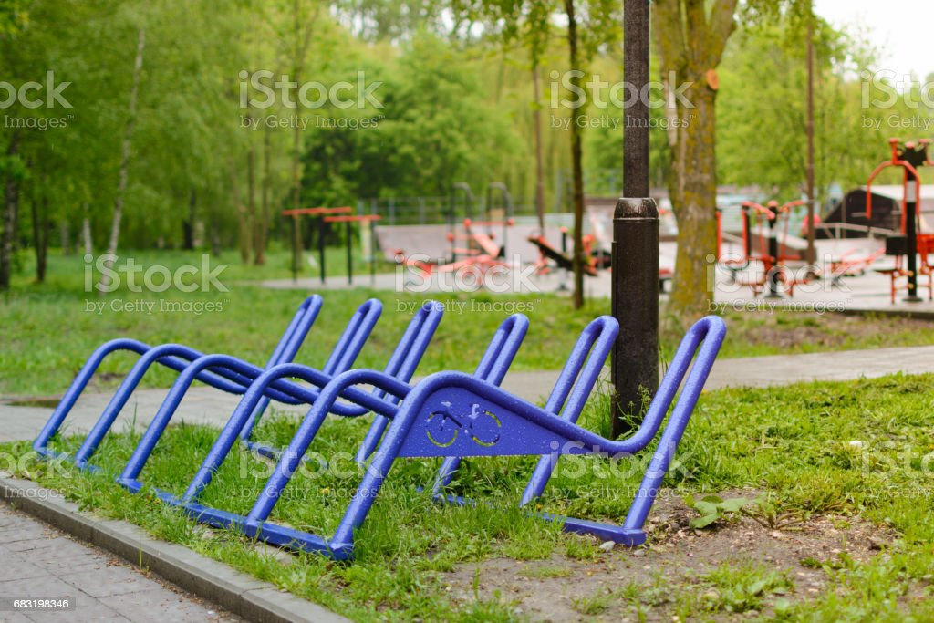 Parking for bicycles in the park. After the rain. stock photo