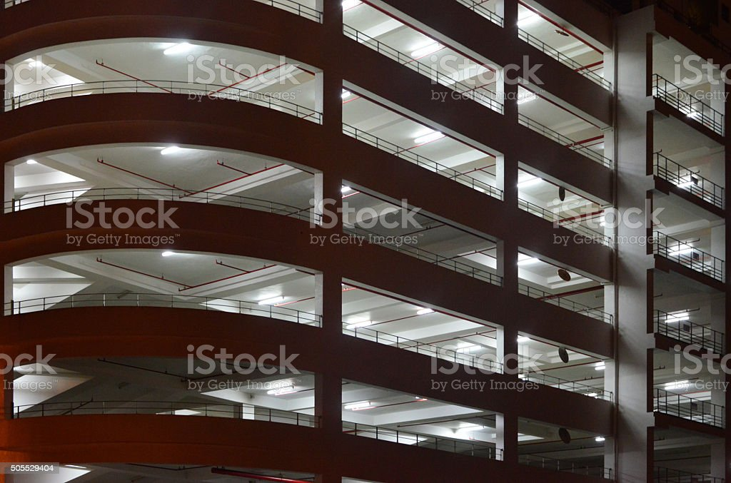 Parking Garage building at night stock photo