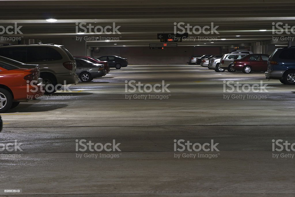 Parking Garage Level Interior at Night with Parked Vehicles royalty-free stock photo