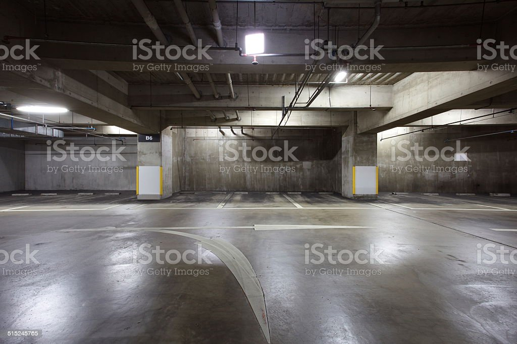 Parking garage underground interior, neon lights in dark stock photo