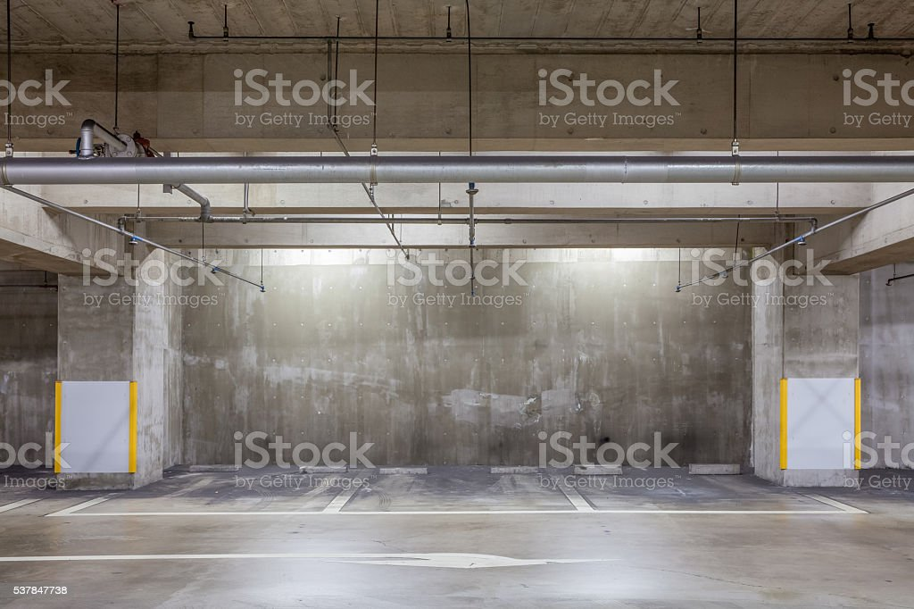 Parking garage underground interior with neon lights stock photo