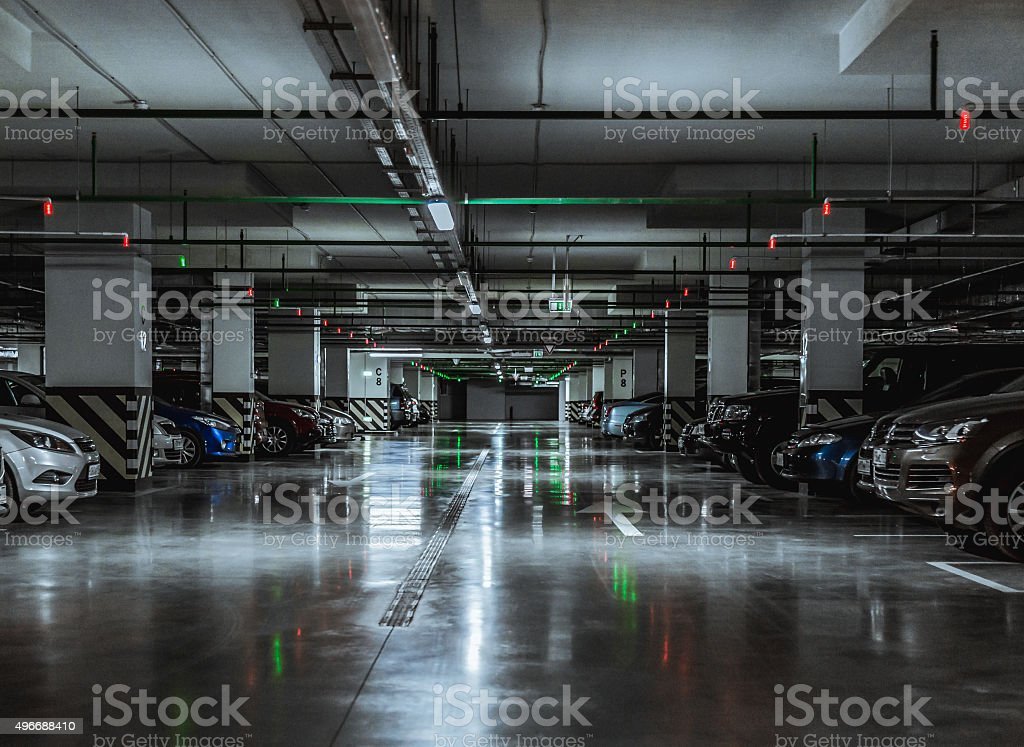 Parking garage with a few parked cars stock photo