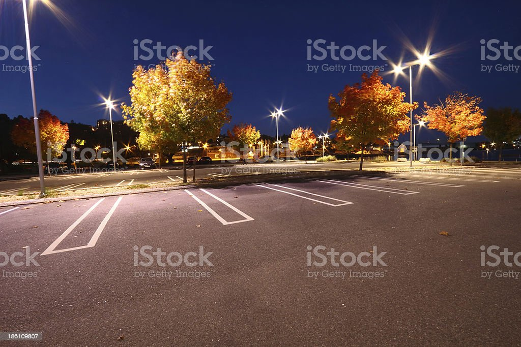 Parking lot an evening in fall viewed from asphalt level royalty-free stock photo