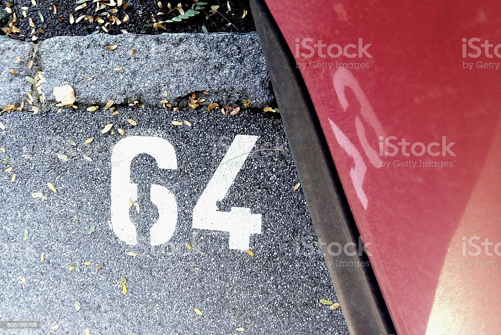 Parking lot number 64 stock photo