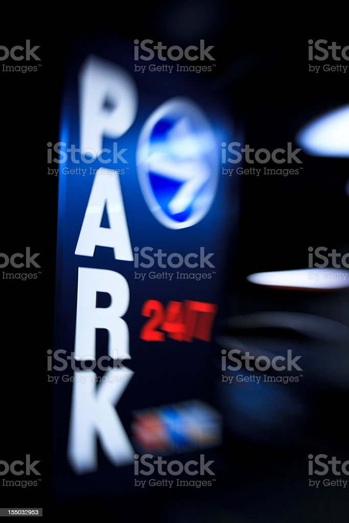 PARK 24/7 - parking luminous sign in the night stock photo