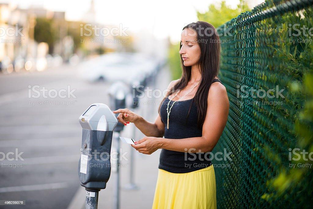 Parking meter usage stock photo