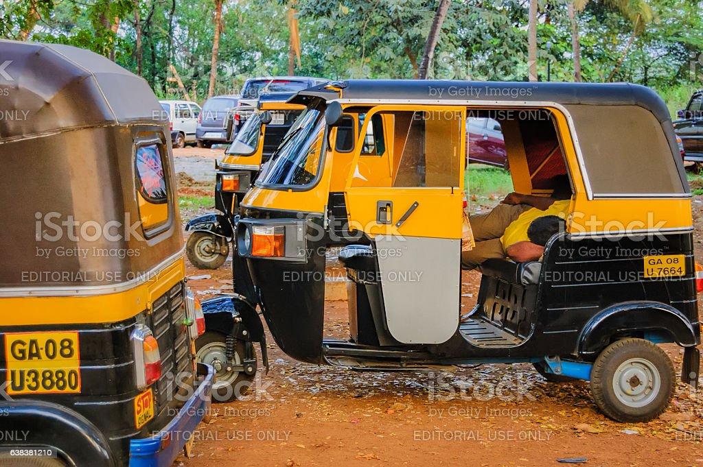 Parking of rickshaws and rickshaw asleep stock photo