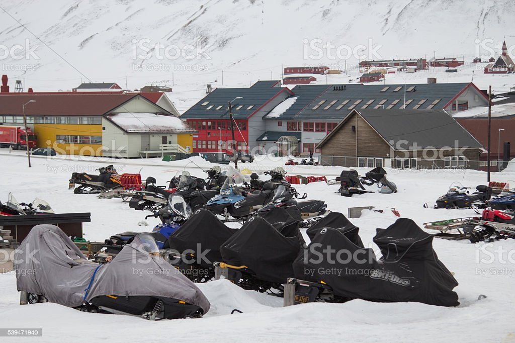 Parking of snowmobiles in Longyearbyen, Svalbard. stock photo