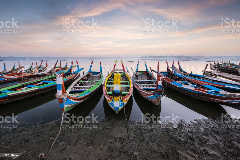 Parking paddle boats at U-Bein bridge, Myanmar stock photo