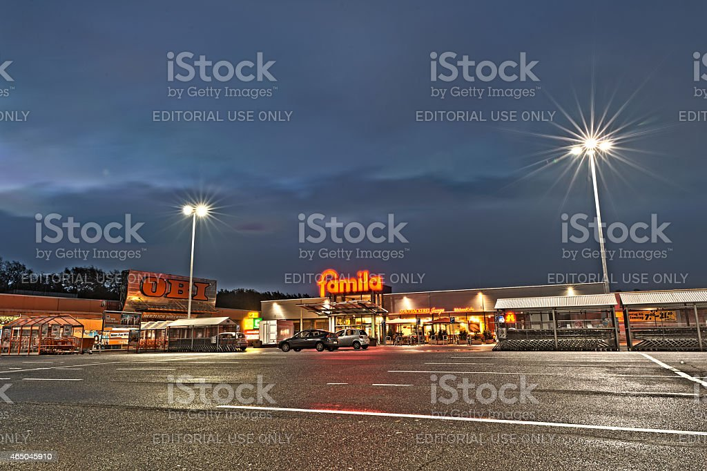 Parking place at a shopphing area around midnight stock photo