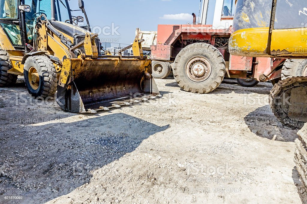 Parking place at construction site, machinery stock photo