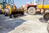 Parking place at construction site, machinery