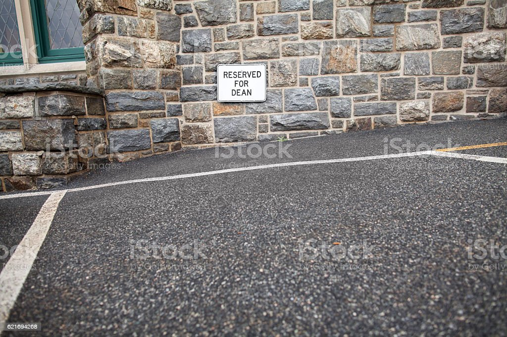 Parking space sign for Dean of a college stock photo