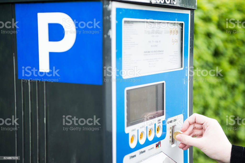 Parking ticket machine - hand paying stock photo