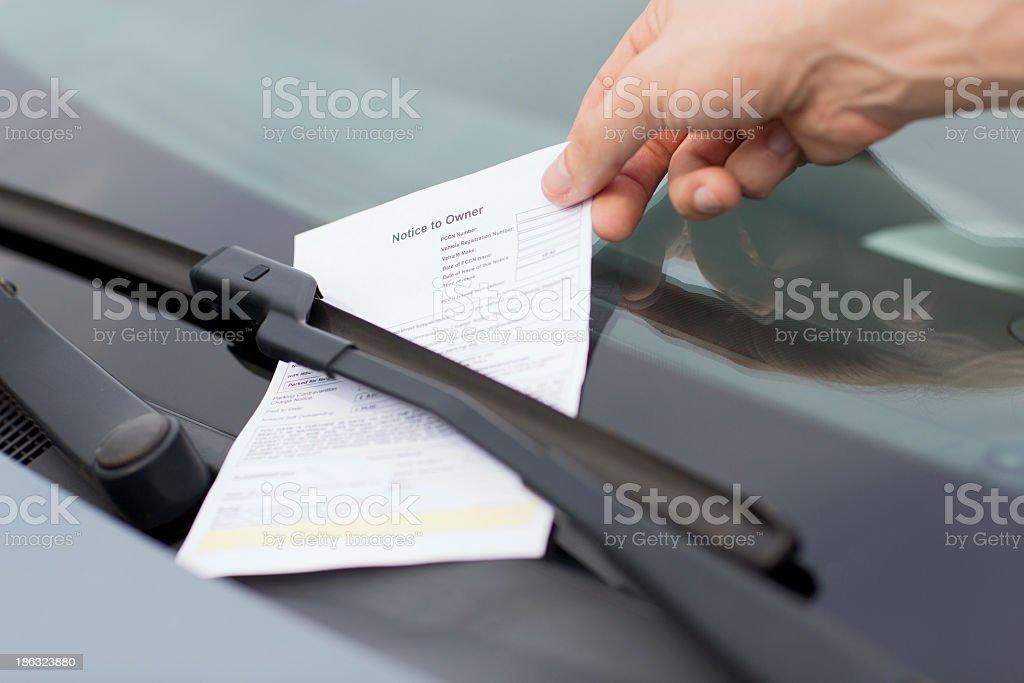 parking ticket on car windscreen stock photo
