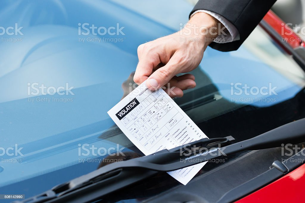 Parking Ticket On Car's Windshield stock photo