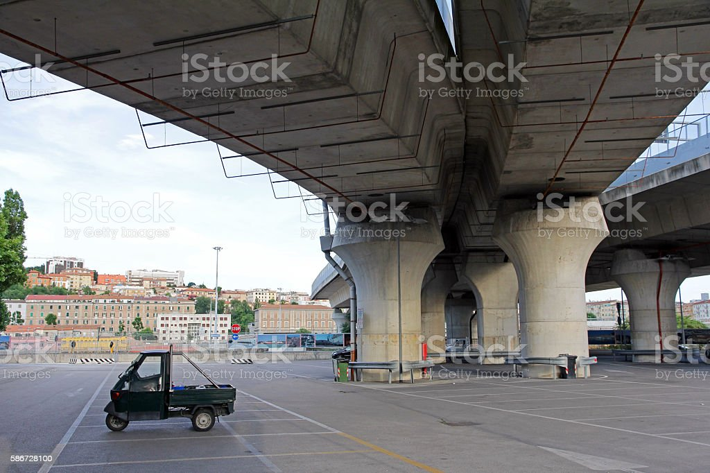 Parking under a bridge in Italy stock photo